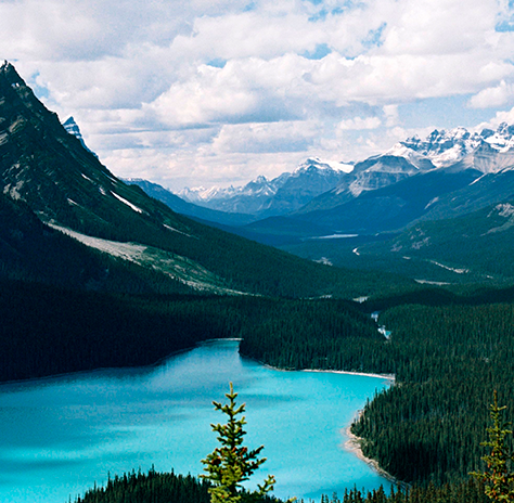 A light blue lake surrounded by mountains.